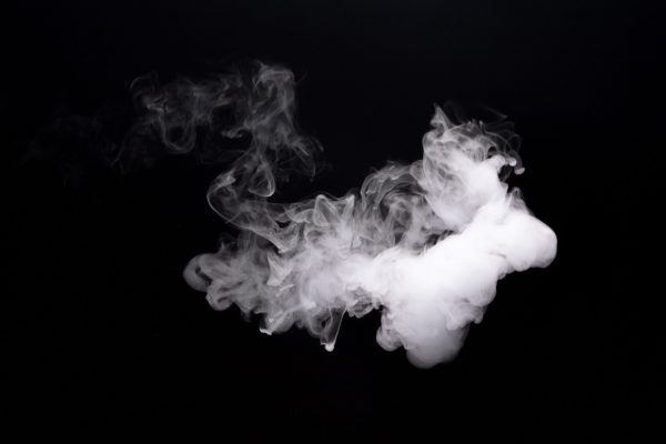 Cloud smoke of e-cigarette on black background